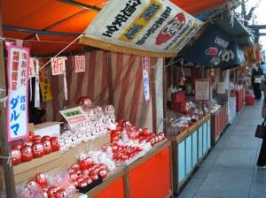 """Booth selling """"Daruma""""."""
