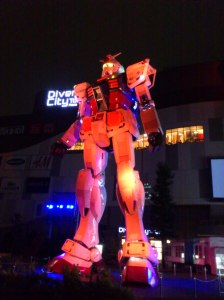 In the evening, the lifesize Gundam robot is lit-up and moves a bit.